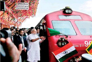 India's Premier Modi flags off the first train from Tlaimannar Pier